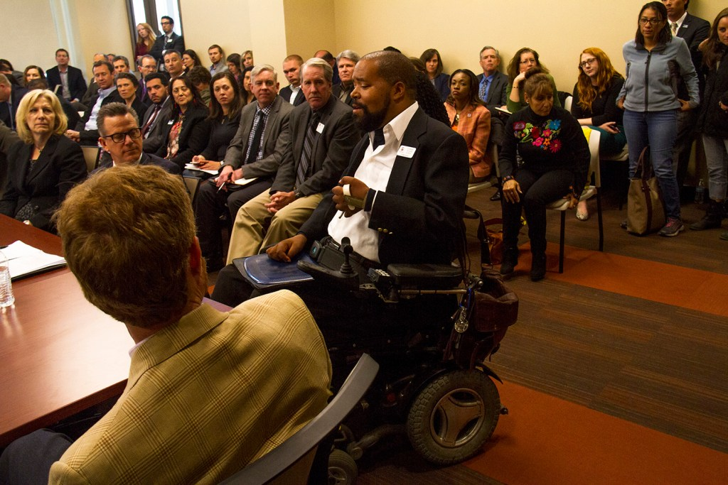 Stuart Tucker Lundy, vice chair of the Denver Commission for People with Disabilities, addresses the roundtable.  anthony foxx; michael hancock; cdot; smart cities; development; growth; infrastructure; transportation; highway; i70; i-70;