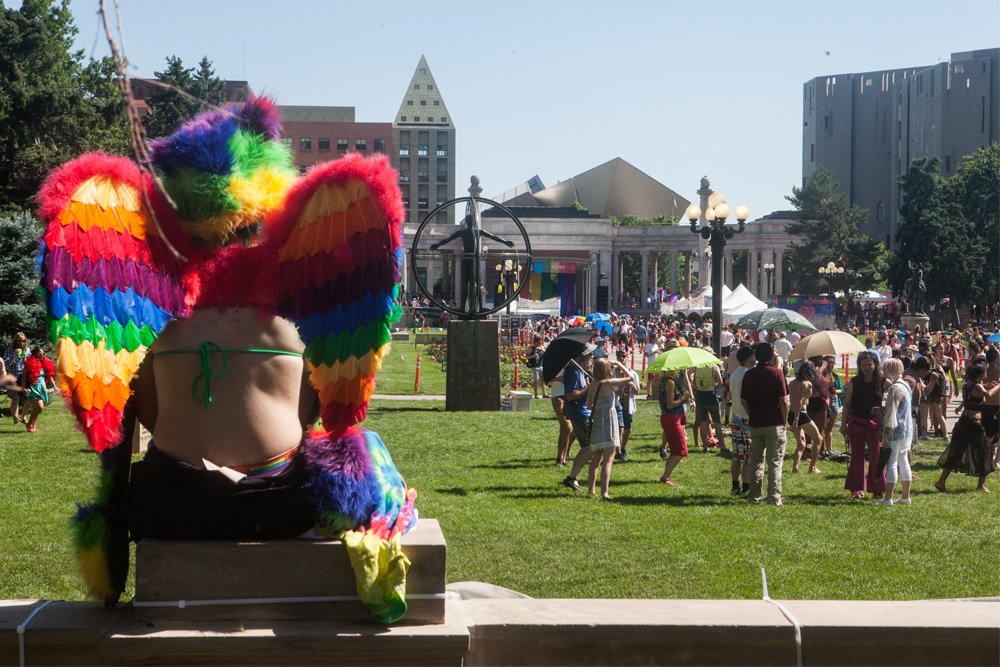 """Megan took a moment to admire the festival. Pride means """"I'm able to love who I want to love,"""" she said. (Chloe Aiello/Denverite)"""