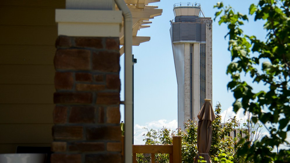 The defunct Stapleton Airport control tower looms over the growing suburban landscape. (Kevin J. Beaty/Denverite)