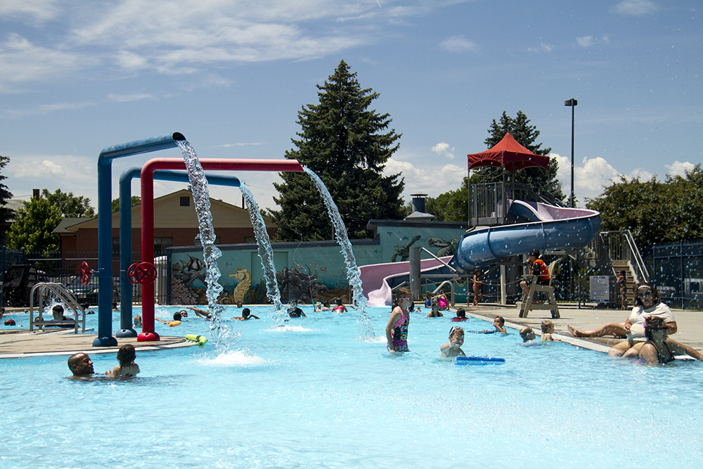 Kids cool off in the pool at Globeville's Argo Park. (Kevin J. Beaty/Denverite)  argo park; globeville; summer; pool; kids; kevinjbeaty; denver; denverite; colorado;