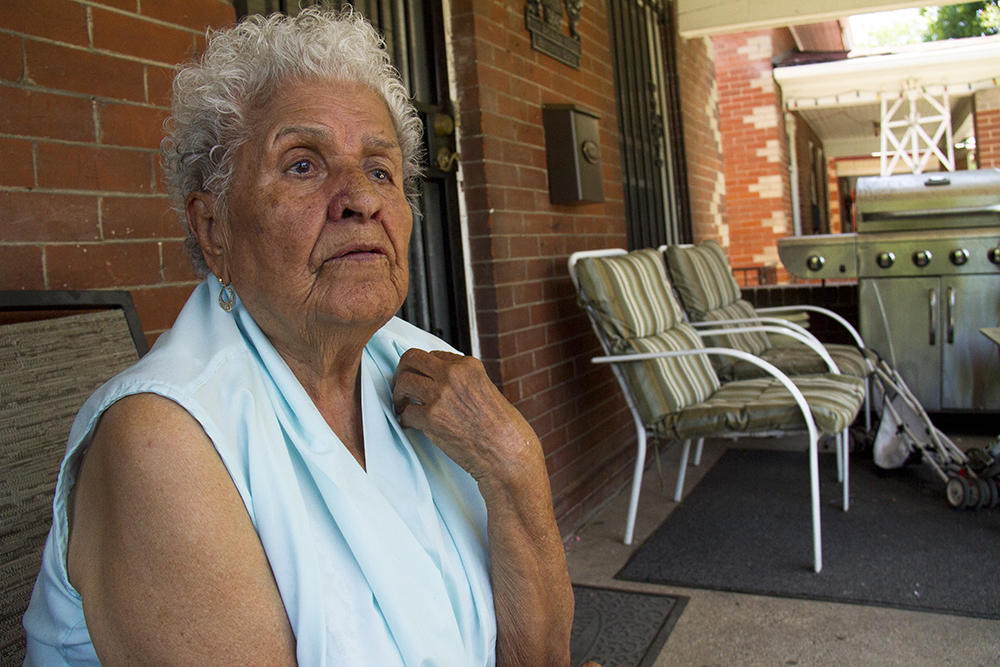 Lupe Garcia on the porch of her home where she's lived since 1970. (Kevin J. Beaty/Denverite)  sunnyside; north side; denver; colorado; kevinjbeaty; denverite