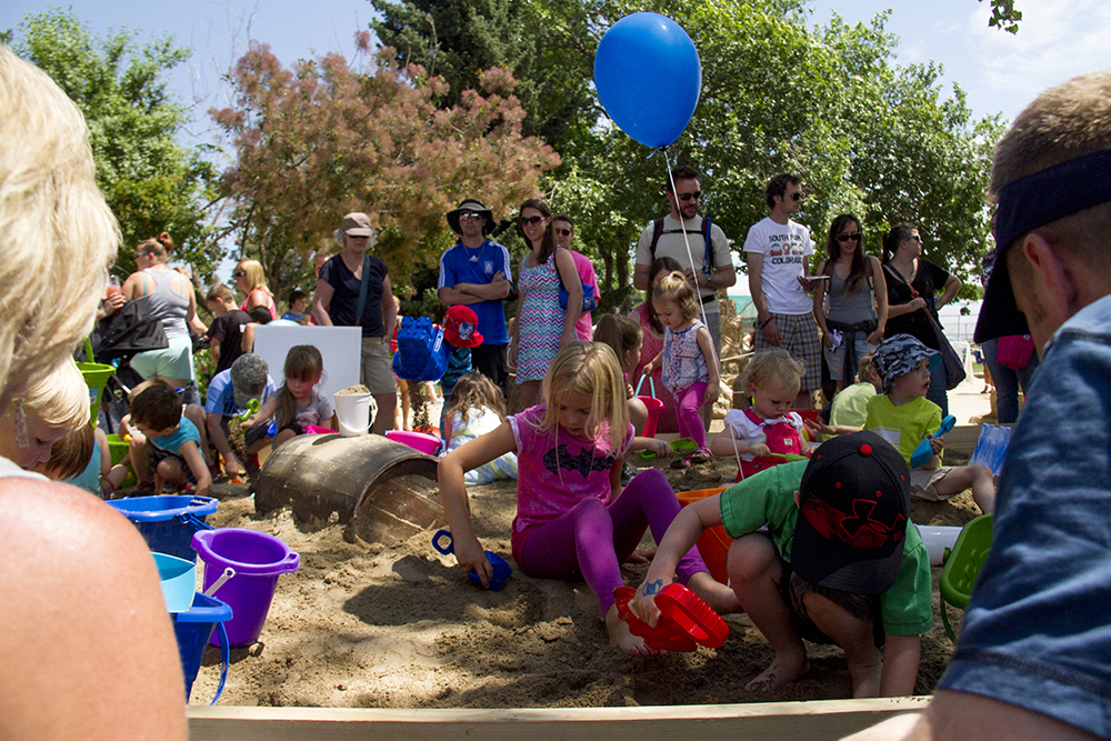 A mass of kids dig for treasure in a sandbox at Arvada's Sand in the City festival on June 25, 2016.(Kevin J. Beaty/Denverite)  sand in the city; sand castle; summer; festival; arvada; denver; kevinjbeaty; denverite; colorado;