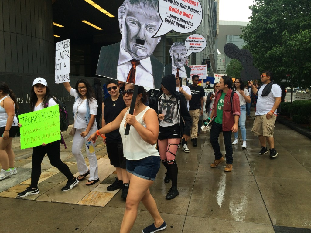 Protesters from Showing Up for Racial Justice march at 15th and California Streets. (Chloe Aiello/Denverite)