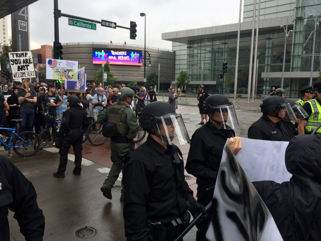 Police in riot gear keep demonstrators apart outside the Western Conservative Summit on Friday, June 1, 2016. (Chloe Aiello/Denverite)