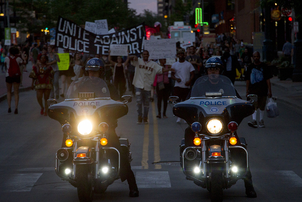 Police motorcycles lead protests in a touch-and-go escort down the 16th Street Mall on July 7, 2016. (Kevin J. Beaty/Denverite)  black lives matter 5280; protest; march; denver; colorado; kevinjbeaty; denverite;