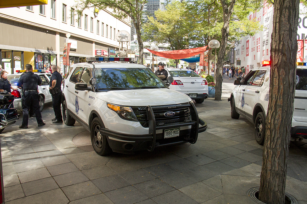 Police presence on the 16th Street Mall has been ratcheted up in recent weeks after several violent incidents in the area went viral. (Kevin J. Beaty/Denverite)  police; 16th street mall; sixteenth street; cbd; central business district; denver; denverite; kevinjbeaty; colorado;