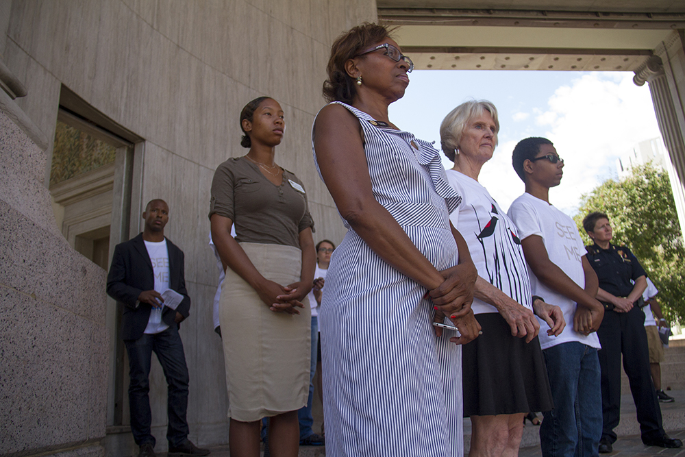 """Colorado State Rep Rhonda Fields stands among speakers from various bar associations who have gathered to speak peace at the """"See Me"""" rally at Civic Center Park. (Kevin J. Beaty/Denverite)  denver; colorado; civic center park; kevinjbeaty; denverite;"""