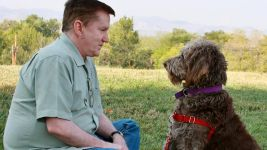 Lon Hodge meets his service dog, Gander, for the first time. (Courtesy of Freedom Service Dogs)