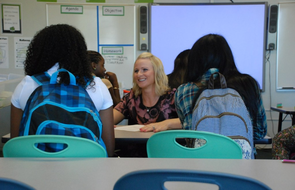 A teacher at DSST Cole High in Denver greets her students on the first day of class in 2014. (Nicholas Garcia/Chalkbeat)