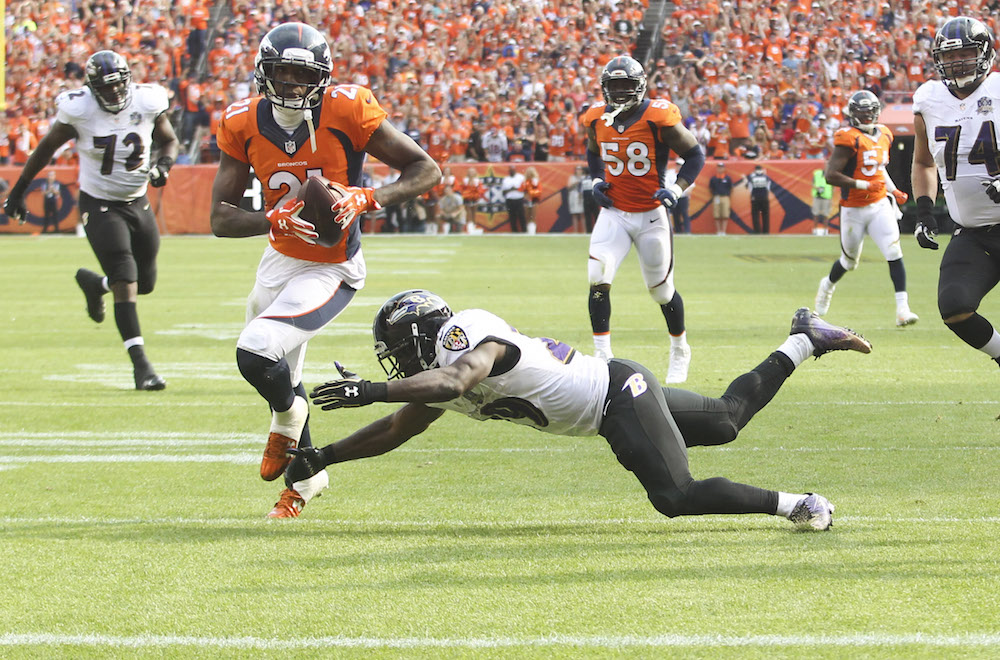 Denver Broncos cornerback Aqib Talib (21) returns an interception 51 yards for a touchdown during fourth quarter action against the Baltimore Ravens in the NFL game at Sports Authority Field in Denver, CO, September 13, 2015. Photo by Ben Hays.