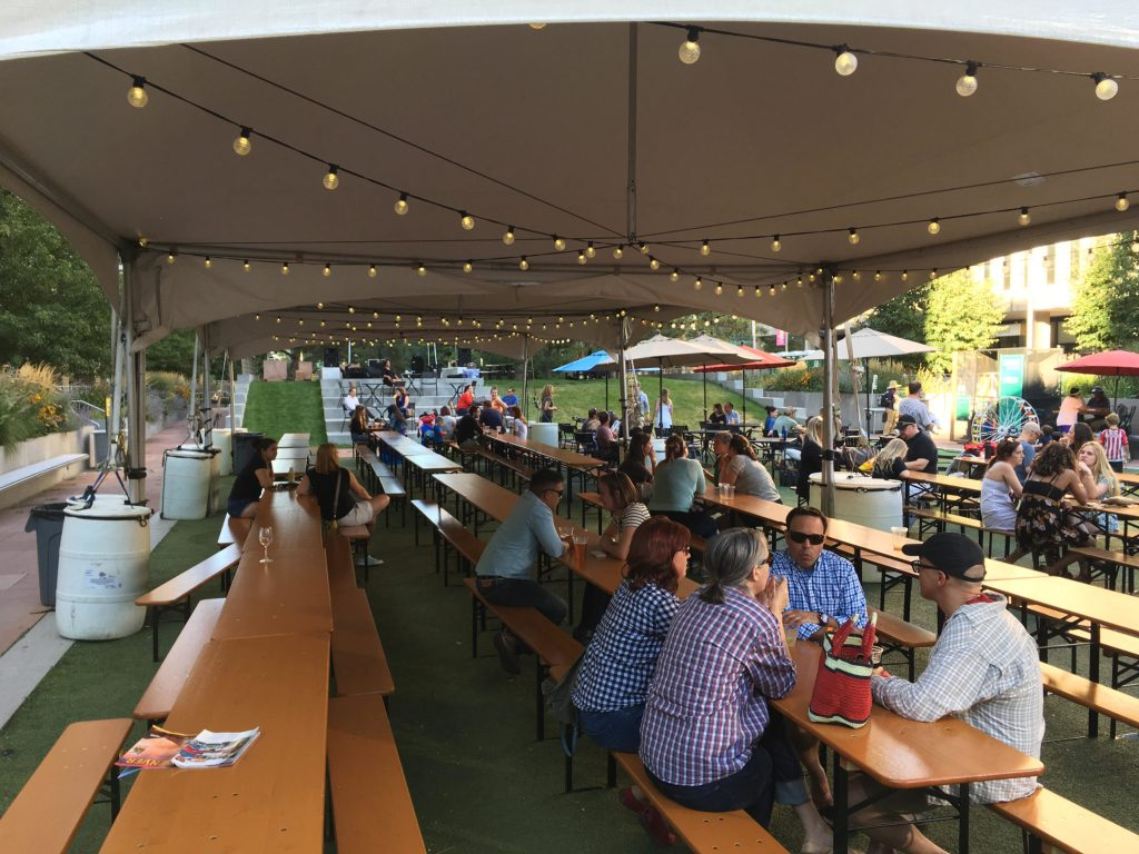 Tables at the beer garden at Skyline Park in downtown Denver. (Dave Burdick/Denverite)
