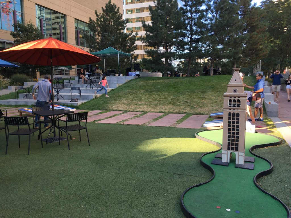 The clocktower miniature golf obstacle in the beer garden at Skyline Park in downtown Denver. (Dave Burdick/Denverite)