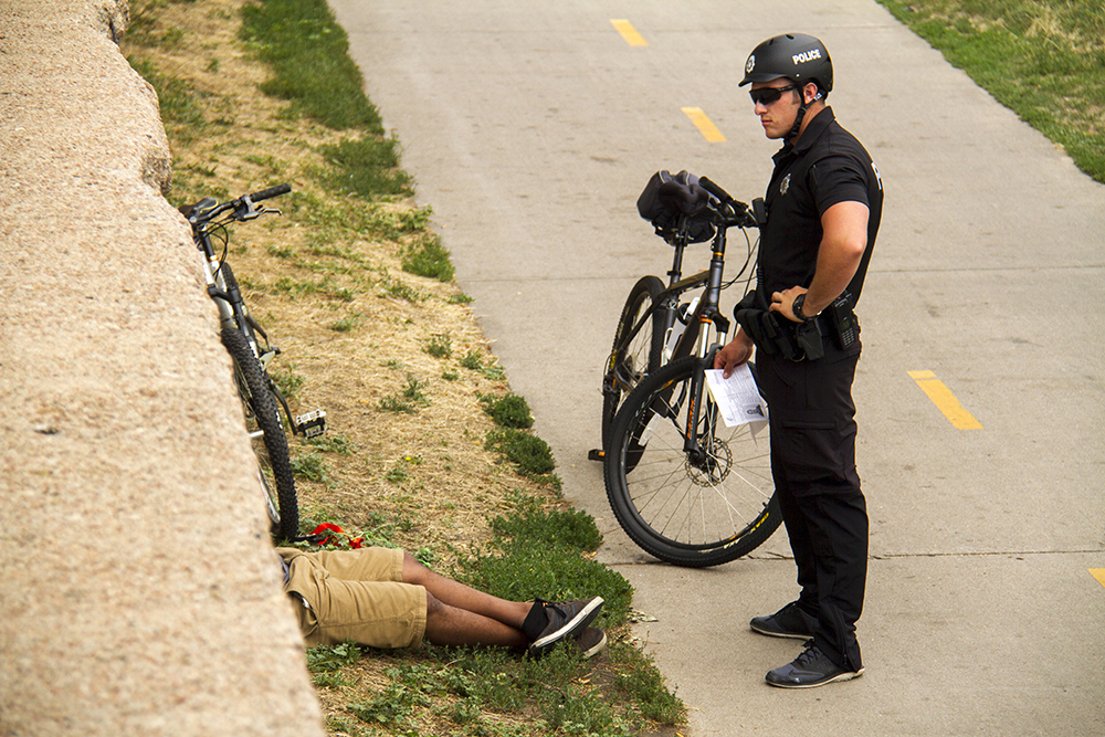 Police arrest three individuals on the Cherry Creek Trail. (Kevin J. Beaty/Denverite)  police; cherry creek trail; denver; kevinjbeaty; colorado; denverite; crime;
