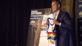 Owner Josh Kroenke presents a Dikembe Mutombo jersey, announcing thay the team will retire his number. Denver Nuggets press day, Sept. 26, 2016. (Kevin J. Beaty/Denverite)  pepsi center; nuggets; basketball; sports; kevinjbeaty; denver; colorado; denverite;