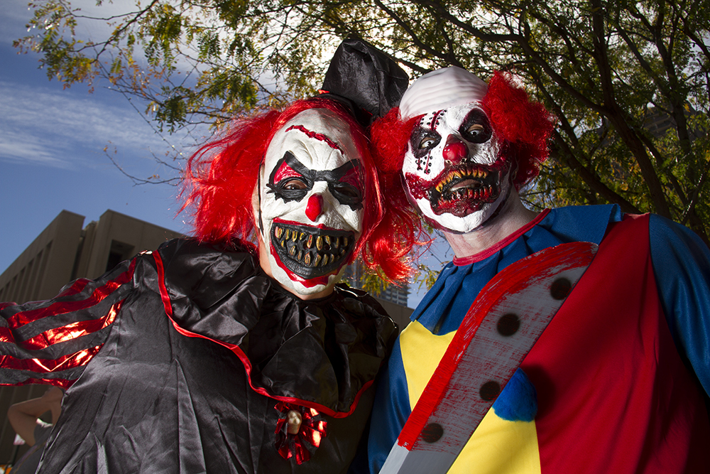 Mario Garcia (right) and Eric Maes found the one appropriate place to be creepy clowns. Denver Zombie Crawl. Oct. 22, 2016. (Kevin J. Beaty/Denverite)  zombie crawl; halloween; cosplay; 16th street mall; sixteenth street; kevinjbeaty; denver; colorado; denverite; cbd;