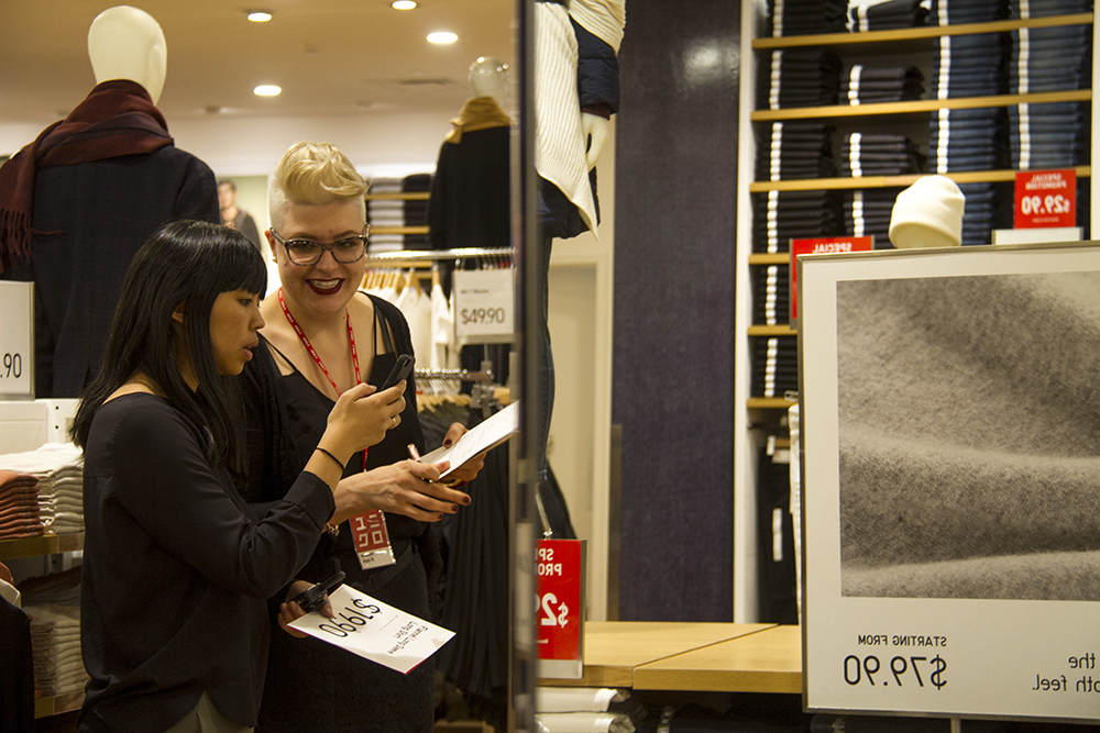 Manager-in-training Anni Raini (right) and area manager Shelly Wu look through last-minute issues before UNIQLO opens tomorrow on the 16th Street Mall. (Kevin J. Beaty/Denverite)  retail; commercial; denver; uniqlo; 16th street mall; sixteenth street; kevinjbeaty; denverite; colorado;