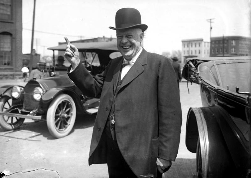Denver Mayor Robert W. Speer, smiles for the camera. He wears a dark pin striped suit and bowler hat. Between 1904 and 1918. (Harry Mellon Rhoads/Denver Public Library/Western History Collection/Rh-862)  historic; denver public library; dpl; archive; archival; denverite
