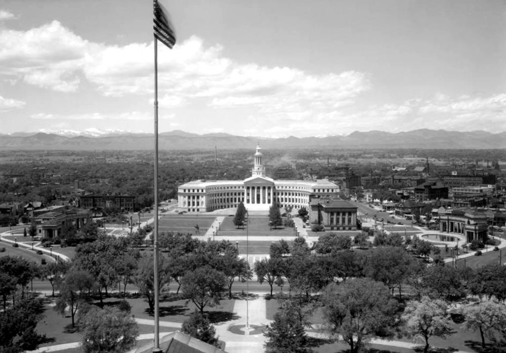 View from Colorado State Capitol roof across Civic Center to unfinished white granite Denver City & County building, masterpiece of City Beautiful period. 1932. (Louis Charles McClure/Denver Public Library/Western History Collection/MCC-3116)  historic; denver public library; dpl; archive; archival; denverite