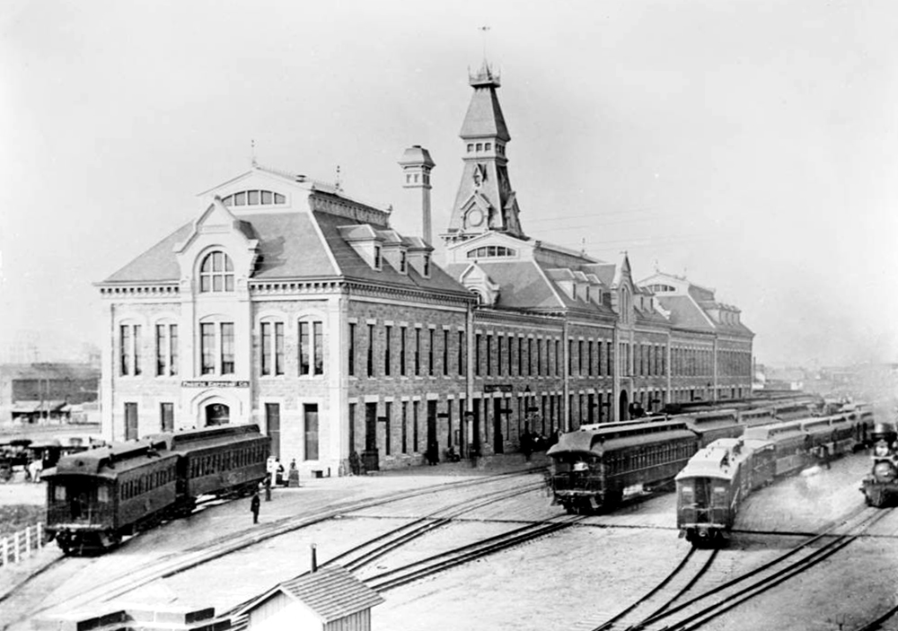 Northwest facade of old Union Station, Eighteenth and Wynkoop streets. Opened in 1881; this view prior to the 1894 fire, after which a larger clock tower was added. Between 1880 and 1900. (Louis Charles McClure/Denver Public Library/Western History Collection/MCC-3281)  historic; denver public library; dpl; archive; archival; denverite
