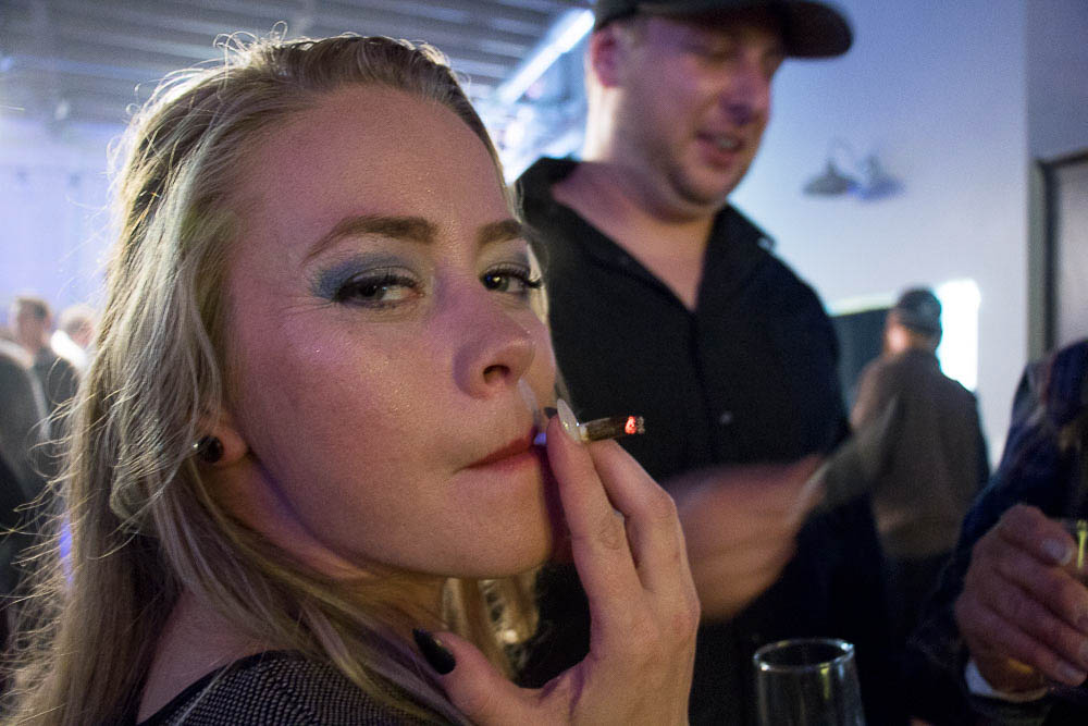 Liz hits a joint at Chong's Choice launch party in RiNo. (Chloe Aiello/Denverite)