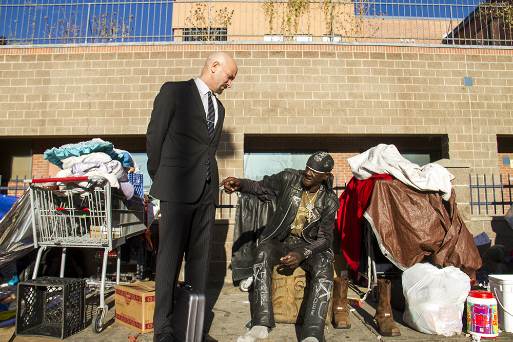 """Attorney Jason Flores-Williams (left) and Jones speak before """"homeless sweeps"""" on Nov. 15, 2016. (Kevin J. Beaty/Denverite)  homeless; sweeps; denver rescue mission; police; justice; kevinjbeaty; denver; denverite; colorado; camping ban; right to rest;"""