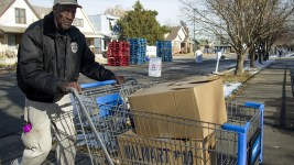 "Epworth Foundation volunteer ""Sweetwater"" Moore pushes a cart with donated Thanksgiving meals to a neighbor's home. Nov. 11, 2016. (Kevin J. Beaty/Denverite)  High Street United Methodist Church; five points; bruce randolph; thanksgiving; volunteer; charity; community service; kevinjbeaty; denver; denverite; colorado;"