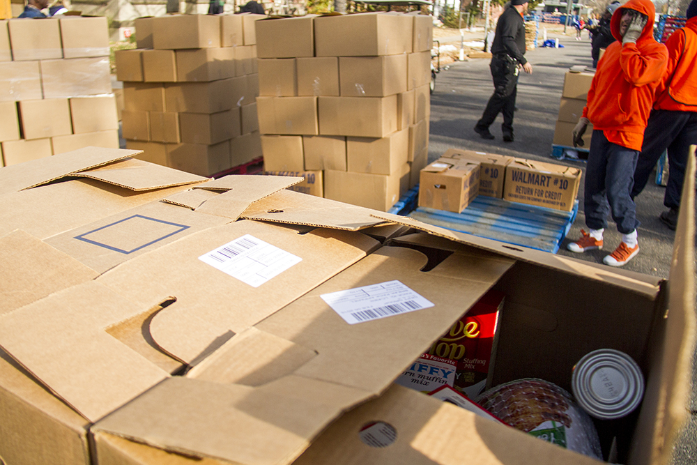 The Epworth Foundation gives out Thanksgiving meal boxes. Nov. 11, 2016. (Kevin J. Beaty/Denverite)  High Street United Methodist Church; five points; bruce randolph; thanksgiving; volunteer; charity; community service; kevinjbeaty; denver; denverite; colorado;