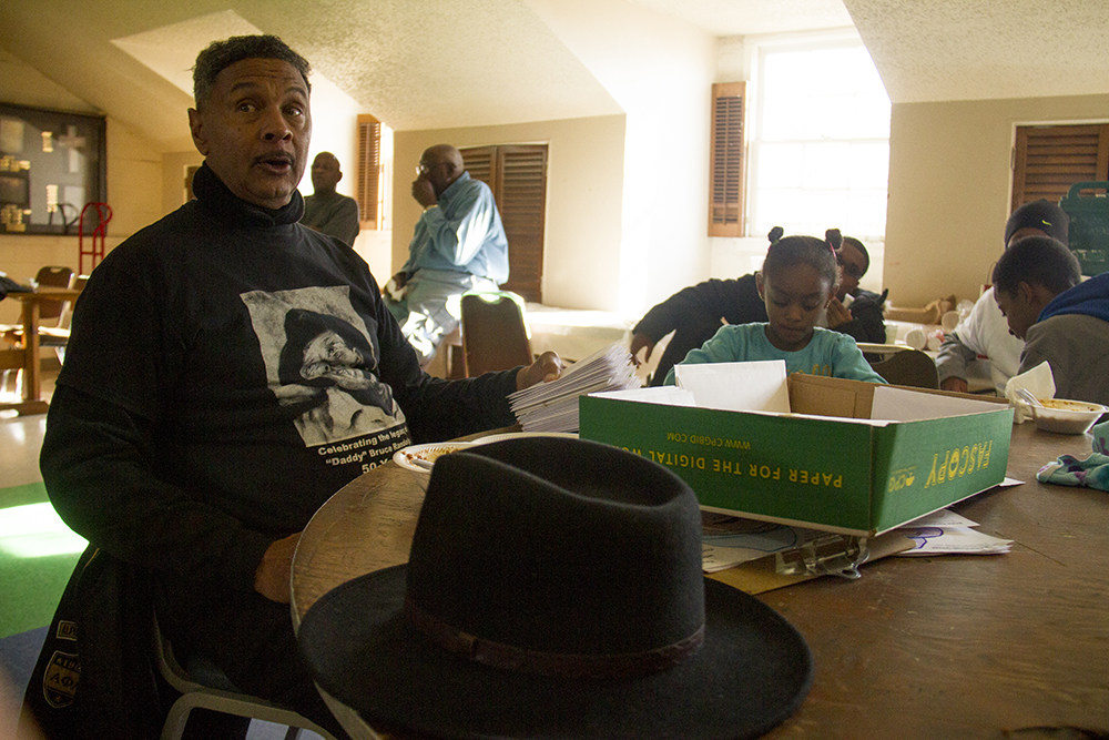 "Ronald Wooding talks about the documentary he produced on ""Daddy"" Bruce Randolph that premiered this week after 14 years of work. The Epworth Foundation gives out Thanksgiving meal boxes. Nov. 11, 2016. (Kevin J. Beaty/Denverite)  High Street United Methodist Church; five points; bruce randolph; thanksgiving; volunteer; charity; community service; kevinjbeaty; denver; denverite; colorado"