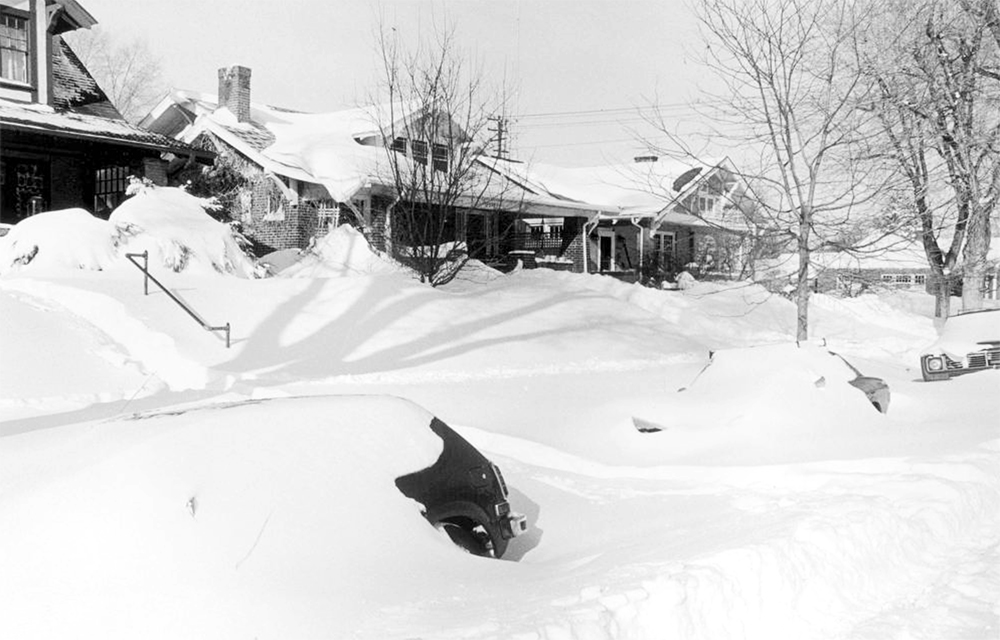 View of automobiles, houses and yards, buried in snow drifts, after the 1982 snowstorm, 2377 Elm Street in the South Park Hill neighborhood of Denver Colorado. (Allison St. Claire/Denver Public Library/Western History Collection/X-29025)  archive; archival; historic; denver public library; dpl; western history collection; blizzard; snowstorm; weather; cowx; denverite; denver; colorado;