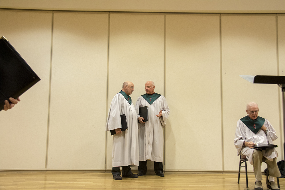 Don peterson (left) and Dave Licko chat before the 7 P.M. service. Christmas Eve at Trinity United Methodist Church, 2016. (Kevin J.Beaty/Denverite)  christmas eve; holidays; downtown; kevinjbeaty; denver; denverite; colorado;