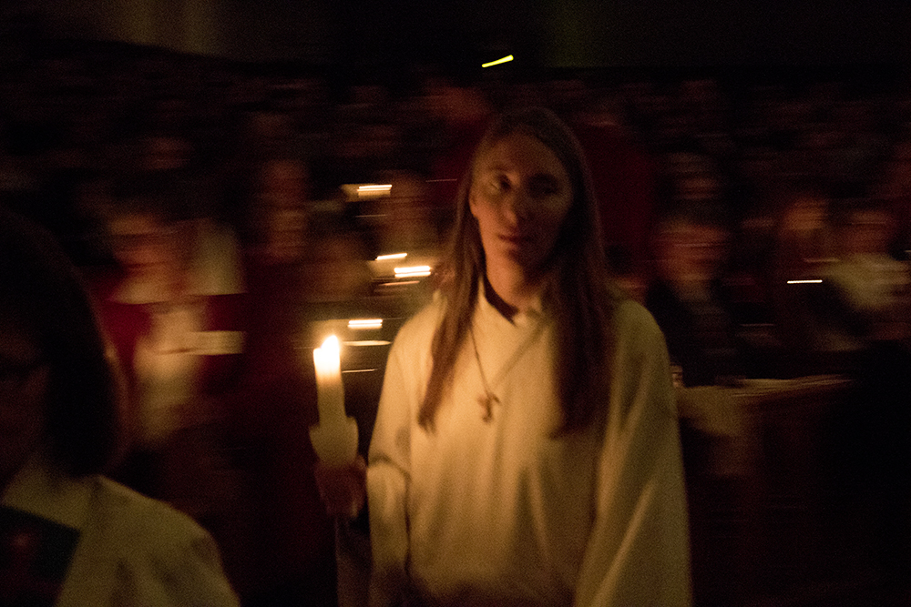 The grand candle-lit end to the 7 P.M. service. Christmas Eve at Trinity United Methodist Church, 2016. (Kevin J.Beaty/Denverite)  christmas eve; holidays; downtown; kevinjbeaty; denver; denverite; colorado;