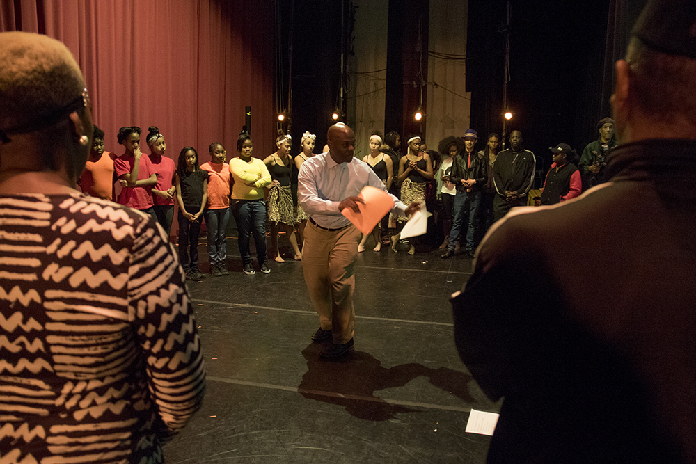 """""""Brother"""" Jeff Fard peps up dancers before the show. The first night of Kwanzaa at the Cleo Parker Robinson Dance Theatre, Dec. 26, 2016. (Kevin J. Beaty/Denverite)  kwanzaa; Cleo Parker Robinson Dance Theatre; holidays; denver; denverite; kevinjbeaty; colorado; five points;"""