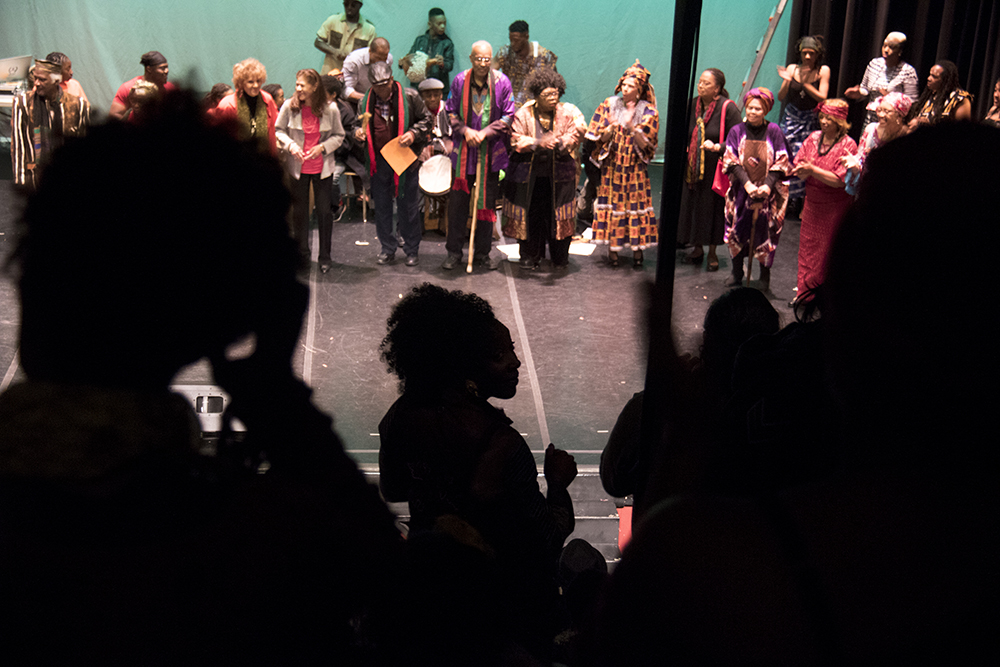 The crowd stands to applaud as community elders are honored on stage. The first night of Kwanzaa at the Cleo Parker Robinson Dance Theatre, Dec. 26, 2016. (Kevin J. Beaty/Denverite)  kwanzaa; Cleo Parker Robinson Dance Theatre; holidays; denver; denverite; kevinjbeaty; colorado; five points;