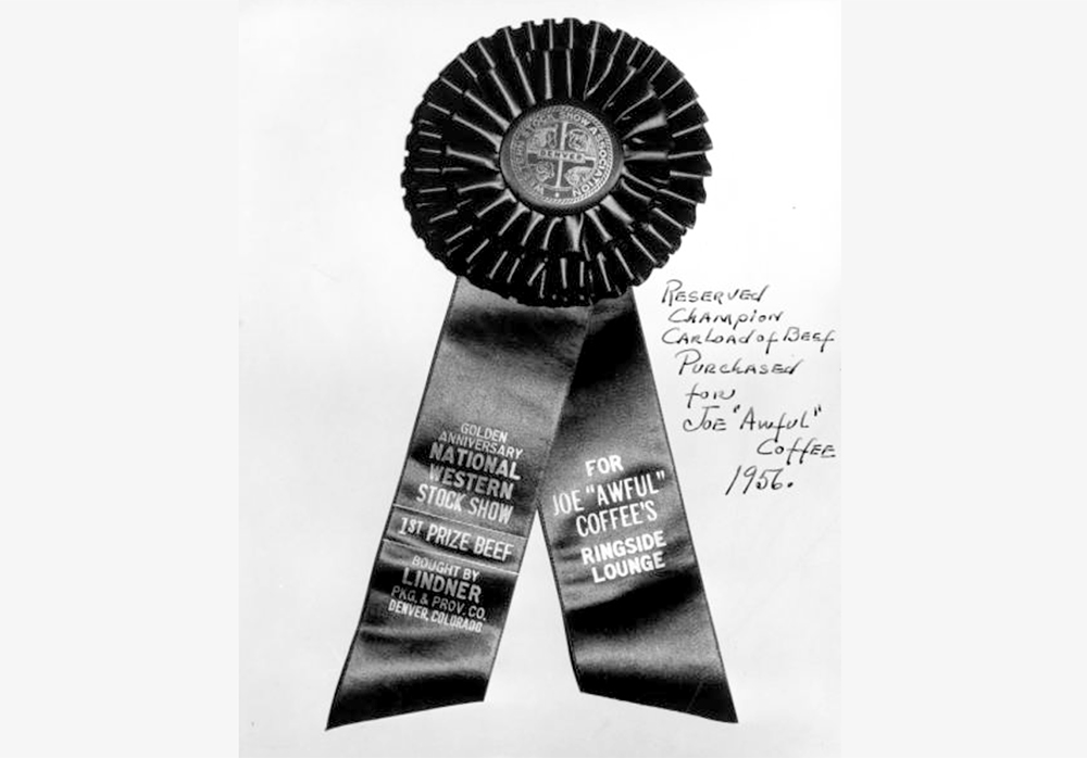 """View of an award ribbon granted to Joe """"Awful"""" Coffee's Ringside Lounge in Denver, Colorado. 1956. (Cloyd M. Teter/Denver Public Library/Western History Collection/X-29471)  denver; denverite; denver public library; western history collection; archive; archival; National Western Stock Show; nwss;"""