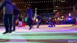 Skaters skitter over the ice at Skyline Park. (Kevin J. Beaty/Denverite)
