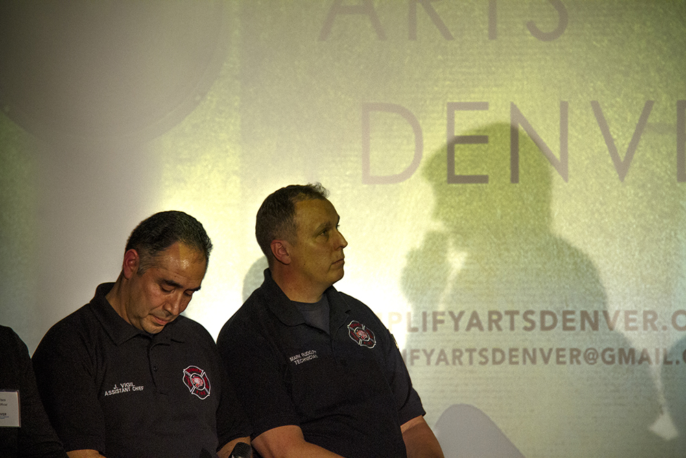 Denver Fire Department Chief Jeremy Vigil (left) and inspector Mark Rudolph beneath the shadows of artists Madeline Johnston. Forum on safe creative spaces at the McNichols building, Jan. 18, 2017. (Kevin J. Beaty/Denverite)  diy; art; mcnichols building; denver; denverite; colorado; art; gentrification;