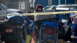 "Amanda Berry (left) watches as city workers ""sweep"" a homeless encampments at Denargo and Delgany Streets where she was staying for two months, Jan. 26, 2016. (Kevin J. Beaty/Denverite)  homelessness; sweeps; right to rest; denver; colorado; kevinjbeaty; denverite;"