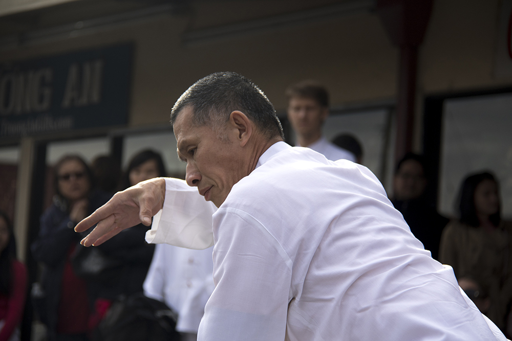 Daniel Ha of Tai Kung Ha Tai Chi demonstrates his art in front of Truong An Far East Asian Gifts during Chinese New Year, Jan. 29. 2017. (Kevin J. Beaty/Denverite)chinese new year; federal boulevard; westwood; denver; kevinjbeaty; denverite; colorado;