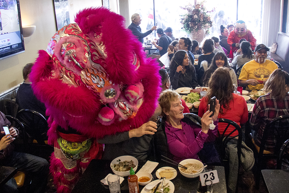 Nguyen Thieu Buddhist Youth Group performers dressed as a lion mauls Richard Borga during Chinese New Year, Jan. 29. 2017. (Kevin J. Beaty/Denverite)  chinese new year; federal boulevard; westwood; denver; kevinjbeaty; denverite; colorado;