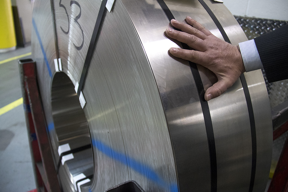 A metal roll from which blank coins will be punched. These rolls are about 1500 feet long. Making money at the U.S. Mint. (Kevin J. Beaty/Denverite)  us mint; money; economics; denver; denverite; civic center; kevinjbeaty