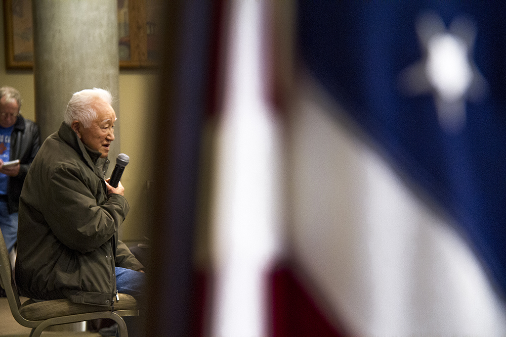 Bob Fuchigami, who remembers life in internment in Colorado, speaks to the crowd. A Day of Remembrance for Japanese-American internment during WWII at the History Colorado Center, Feb. 19, 2017. (Kevin J. Beaty/Denverite)  immigration; japanese americans; internment; history; history colorado center; colorado; denverite; denver; kevinjbeaty;