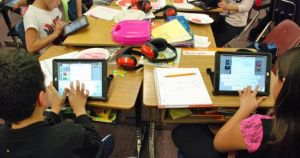 Students at Lumberg Elementary School in Jefferson County work on their assigned iPads during a class project. (Nicholas Garcias/Chalkbeat)