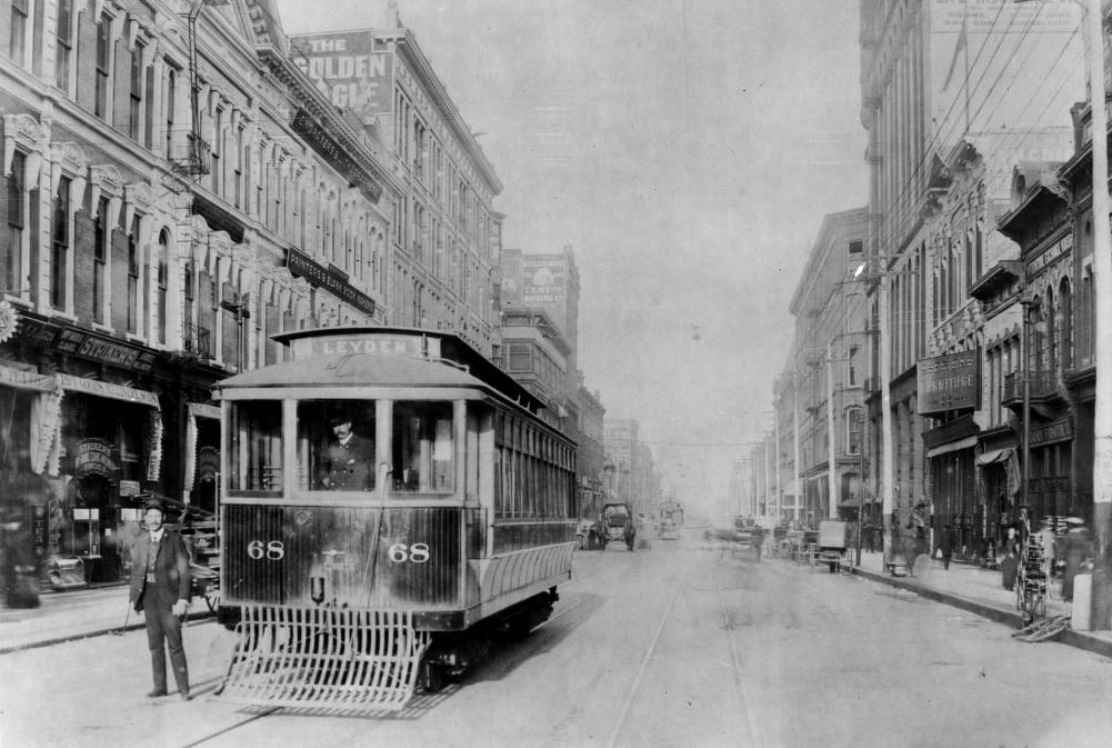 A streetcar conductor and a streetcar operator pose with Denver City Tramway Company car number 68 on Larimer Street between 16th and 17th streets in 1906. (J.E. Kunkle/Western History and Genealogy/Denver Public Library)