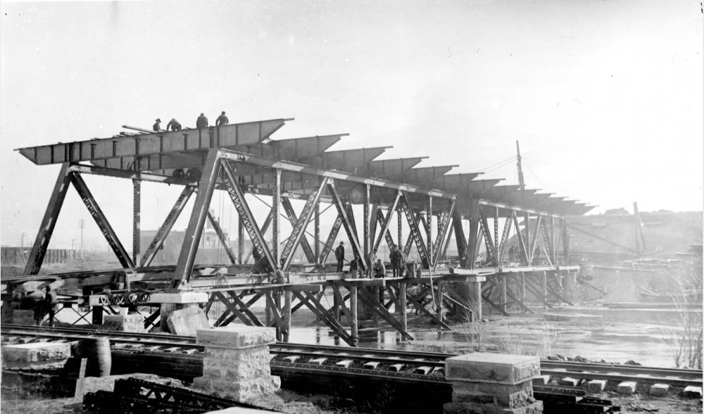A construction crew lays the 14th Street Viaduct across the South Platte River in 1898. The viaduct began at 14th and Wazee and ended at 14th and Platte Street. (Western History and Genealogy Department/Denver Public Library)