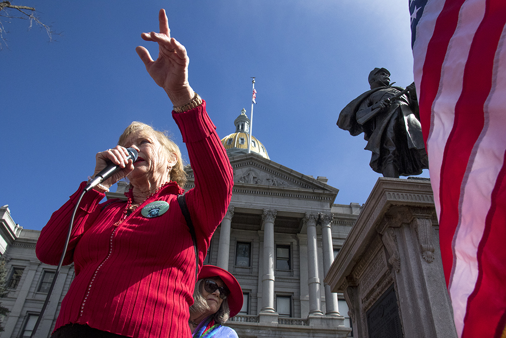 "Helen Shreves leads the rally at the Capitol on the ""day without women,"" Mar. 8, 2017. (Kevin J. Beaty/Denverite)  womens march; day without women; protest; capitol; rally; kevinjbeaty; denver; denverite; colorado;"