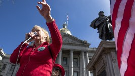 """Helen Shreves leads the rally at the Capitol on the """"day without women,"""" Mar. 8, 2017. (Kevin J. Beaty/Denverite)  womens march; day without women; protest; capitol; rally; kevinjbeaty; denver; denverite; colorado;"""