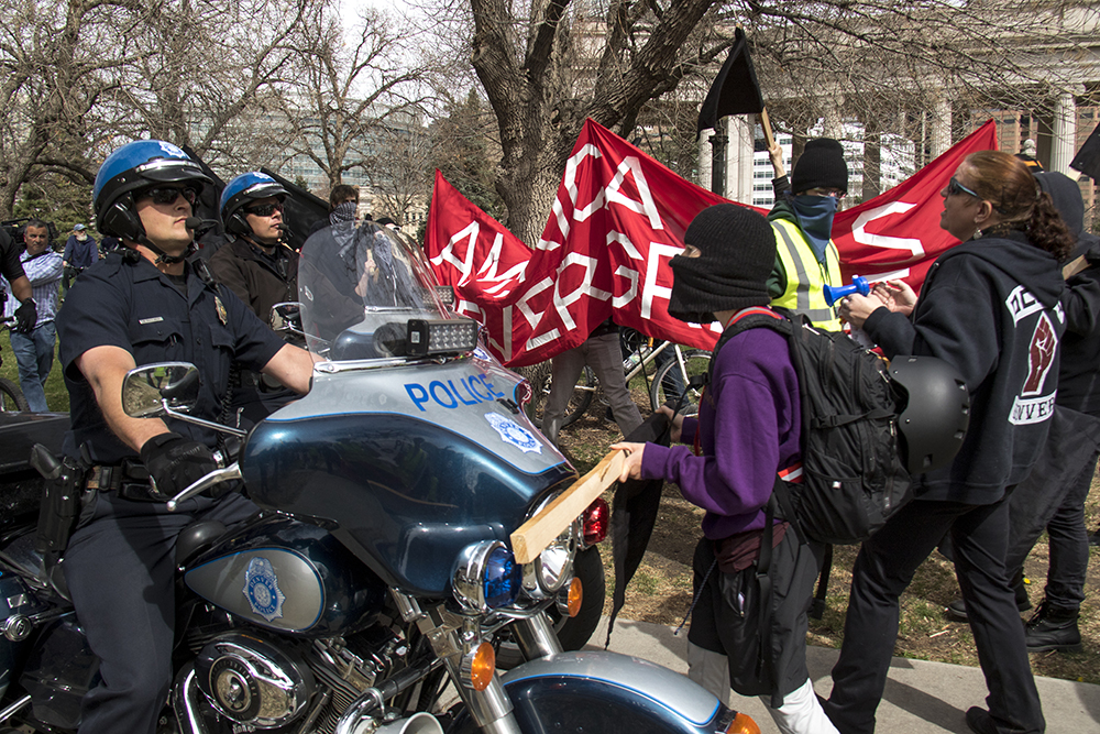 "Counterprotesters outside of a police line surrounding a pro-Trump march. A ""Make America Great Again"" rally at Civic Center Park, March 25, 2017. (Kevin J. Beaty/Denverite)  protest; rally; kevinjbeaty; denverite; denver; colorado; civic center park; copolitics;"