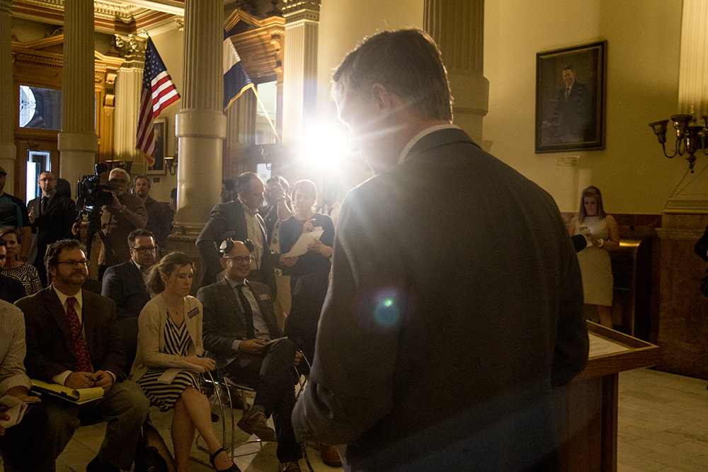 Governor John Hickenlooper before a press conference on a compromise bill to address issues surrounding construction defects, April 19, 2017. (Kevin J. Beaty/Denverite)