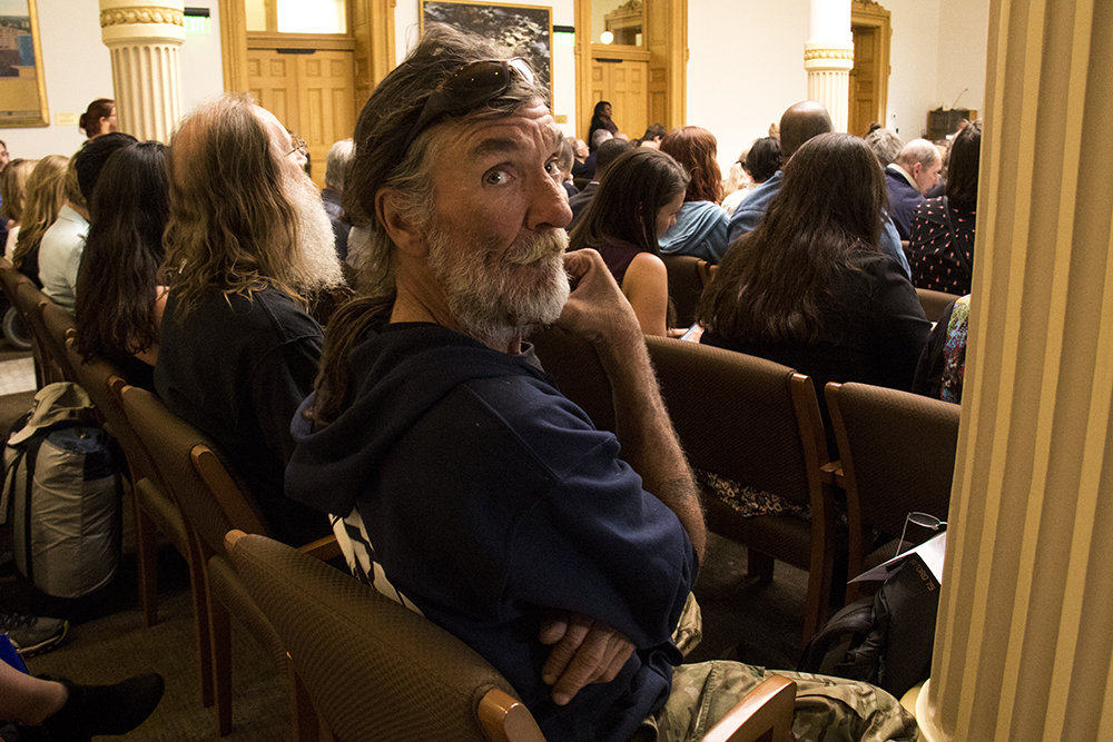 Ray Lyall listens as a bill goes to committee that would ban Denver's urban camping ban at the state level, April 19, 2017. (Kevin J. Beaty/Denverite)