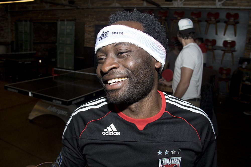 O.B. Fon celebrates his 31st birthday at Ace Eat Serve's weekly table tennis tournament, April 25, 2017. (Kevin J. Beaty/Denverite)  ace; ping pong; table tennis; denver; denverite; colorado; kevinjbeaty; ob fon;